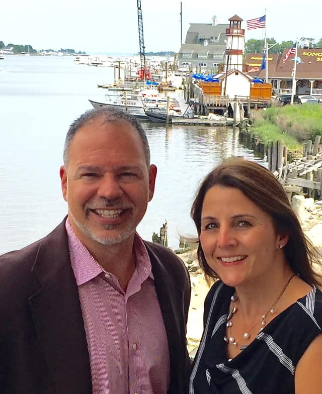Paul Zullo, managing director and co-founder and Donna Bonato, creative director and co-founder from the deck of their new office overlooking Norwalk Harbor.