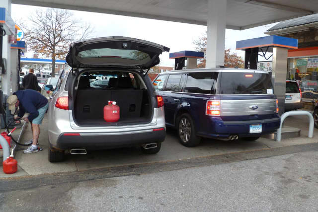 Cars and gas cans were being filled nearly nonstop on Thursday at the New Canaan Gulf Station on South Avenue.