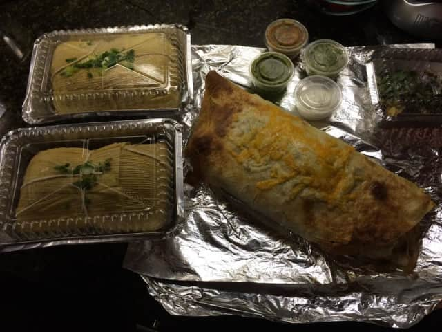 A dish of two tamales and a burrito, offered by the Rincón Taqueria in Norwalk.