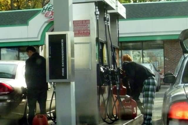 Drivers filling up Tarrytown at the Hess gas station, which still has gas today.