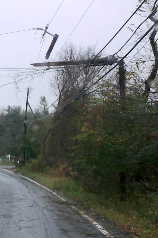 Pound Ridge is plagued by dozens of broken utility poles like this one on Route 124, making power restoration a difficult process.