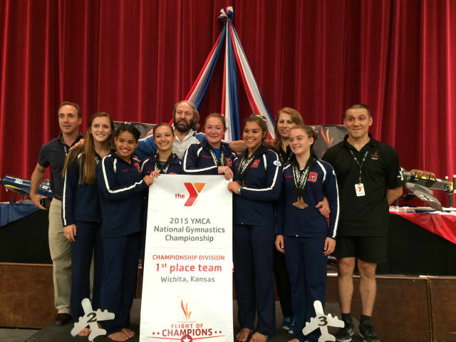 The gymnastic team from the Darien Y  celebrates its championship season.