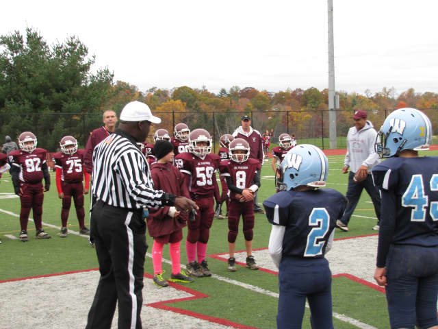 The Valhalla Vikings, in purple, meet the Westlake Wildcats at midfield for the coin toss.