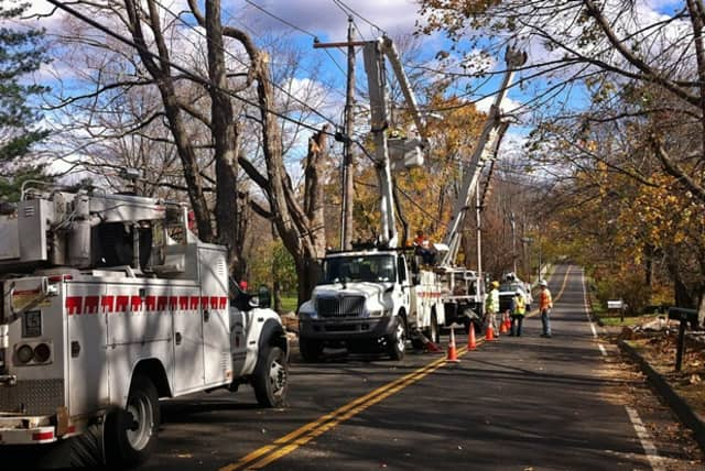 Power line crews work on wires ripped down during winds associated with Hurricane Sandy.
