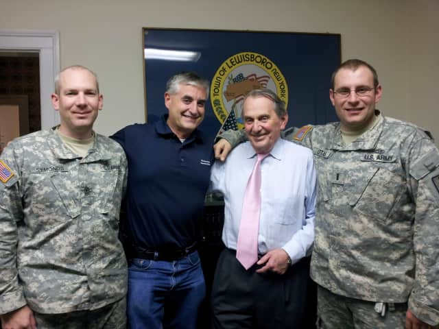 Deputy Supervisor Peter DeLucia, second from left, and Supervisor Peter Parsons, second from right, with two members of the National Guard who arrived Friday to help with the post-Hurricane Sandy clean-up efforts.