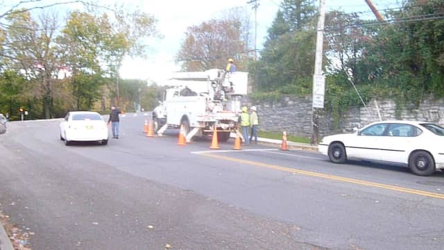 Utility workers prepare to reconnect power in downtown Hastings.