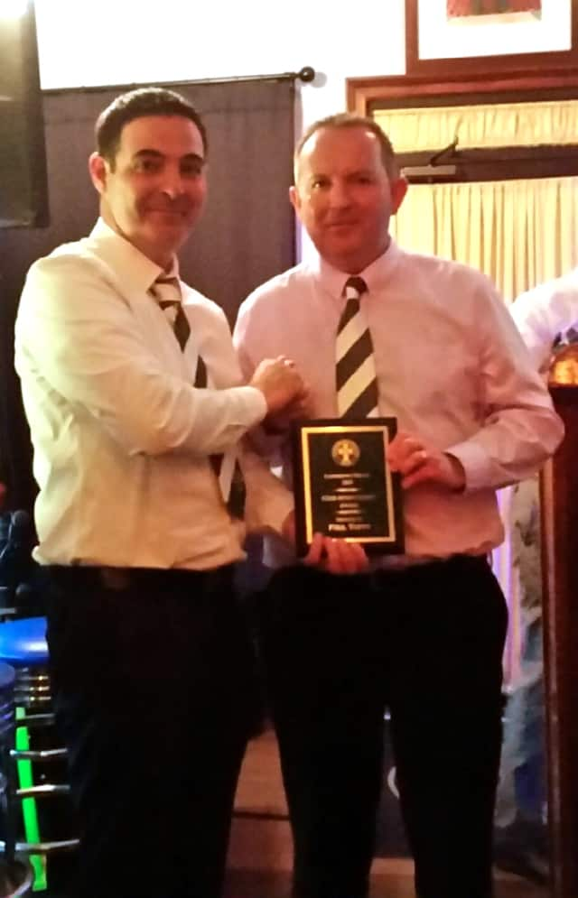 Yonkers businessman Paul Tuffy, right, accepts an award recently from William McGrory, president of the Lansdowne Bhoys Football Club.
