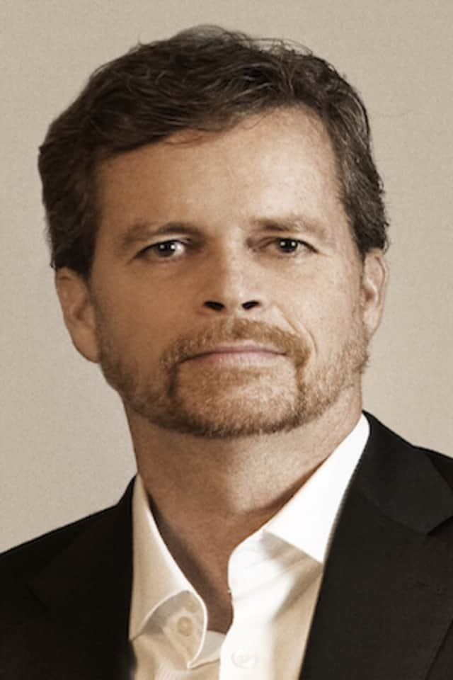 Mark Parker, a graduate of Westhill High School in Stamford, could become the new chairman for Nike.