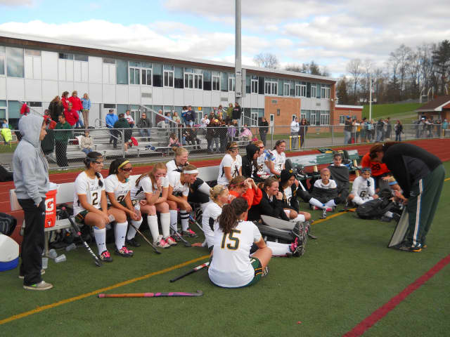 Lakeland coach Sharon Sarsen discusses the first half with her team in the Hornets' 8-0 win over Somers in a Section 1 Class B Field Hockey Championship quarterfinal game Sunday.