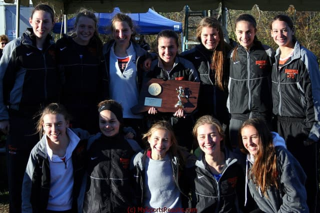 The Ridgefield High girls cross country team wins its second straight State Open title Sunday at Wickham Park in Manchester.