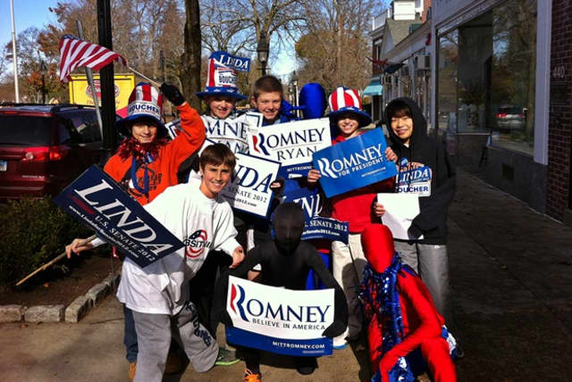 This group of 12-year-old boys was meant to be out just reminding residents to vote, but they took party signs out with them.