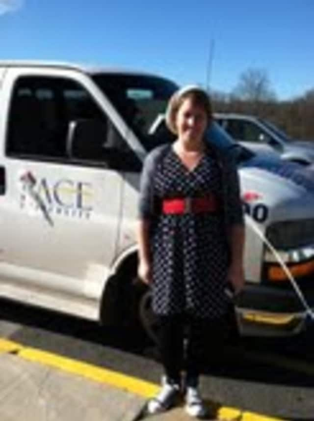 Pace University's Caitlin Kelly and her Voter Van outside Briarcliff High School.