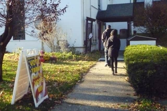 Voters enter Pleasantville Emanuel Lutheran Church to cast ballots Tuesday.