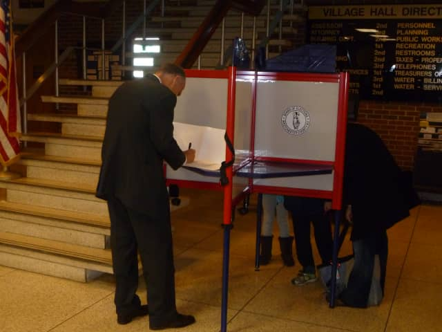 A Scarsdale voter casts his vote at Village Hall.