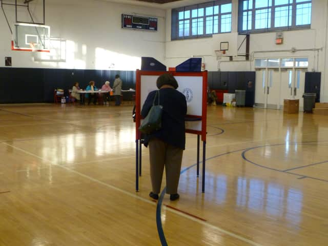 A resident of District 25 in Eastchester casts her vote at  Eastchester High School.