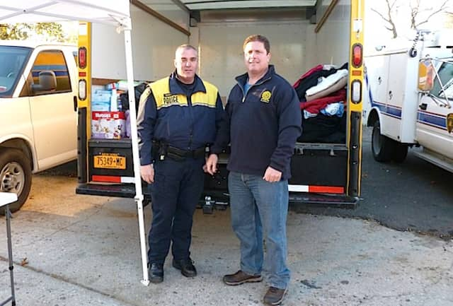From left, Officer Peter Dandreano and PBA President Sean Hagan will collect donations for Hurricane Sandy victims at the Greenburgh Police Department this week.