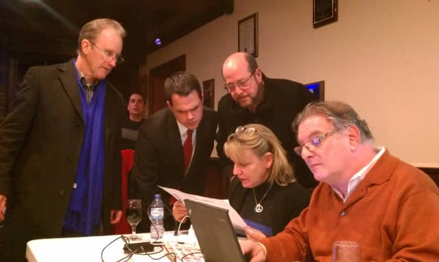David Carlucci, with volunteers and Ossining officials, look over early results from Ossining on Tuesday night.