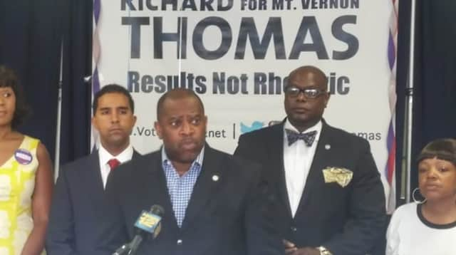Pastor Stephen Pogue of the Greater Centennial A.M.E. Zion Church speaking on behalf of mayoral candidate Richard Thomas (left) about violence in the city.
