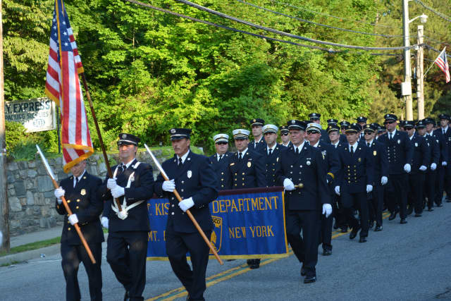 Members of the Mount Kisco Fire Department march in their 2014 parade.