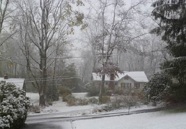 Snow brought by the nor'easter starts to fall in Bedford around midday Wednesday.
