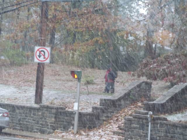 Snow falls Wednesday on Wolfs Lane in Pelham.