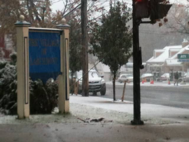 Snow accumulates at Chatsworth Avenue and Boston Post Road, next to CVS Photo, which lost power Wednesday afternoon.