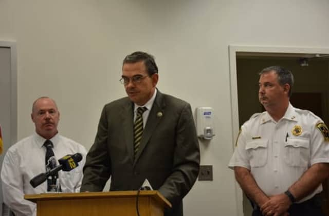 Westchester County Police Commissioner George Longworth (center) at a press briefing Monday in Mount Kisco.
