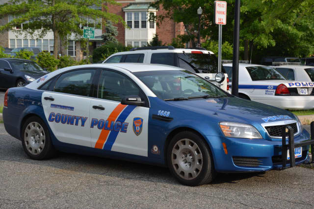 A Westchester County police car parked in Mount Kisco.