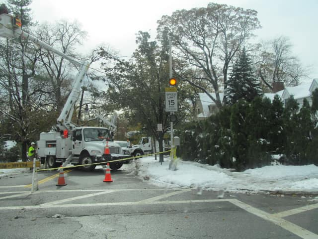 Crews work to restore to Pelham homes still without power from Hurricane Sandy.