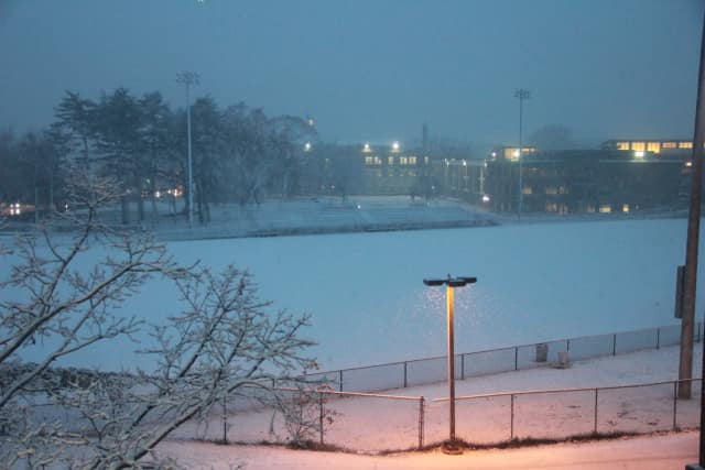 The Mamaroneck High School football field gets covered in snow Wednesday night.