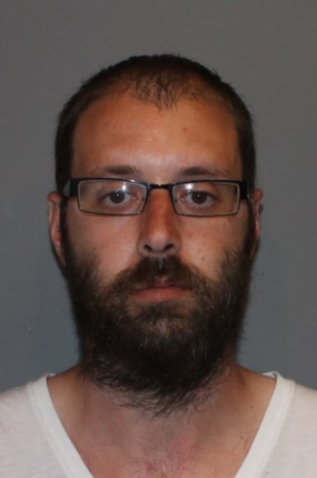 James Dunn, 30, was charged with breaking into his grandparents' house and stealing $4,000 from a safe.
