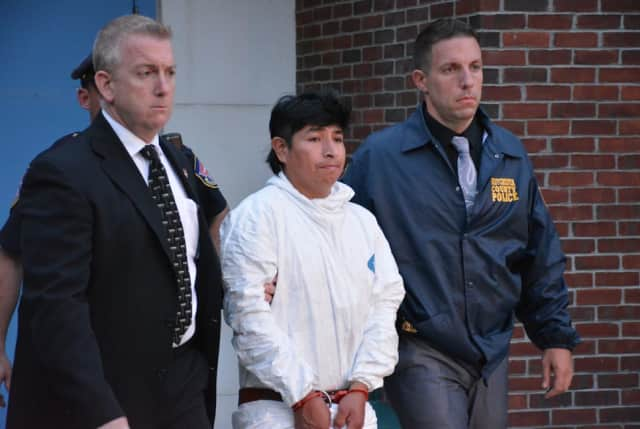 Manslaughter suspect Milton Ventura (center), is escorted from Mount Kisco Justice Court following his arraignment.