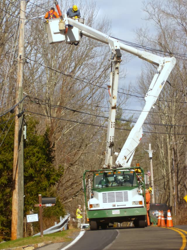 Line crews at work last week in Pound Ridge in the wake of Hurricane Sandy. Power to the town is now nearly completely restored.