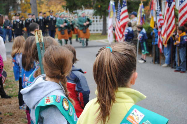 Residents line the street to watch the Veterans Day parade in Yorktown.