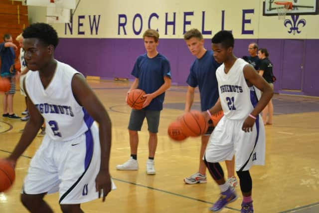 NRHS students happily taught the students of Maritime Regional HS of La Rochelle how to play basketball during their July 2 visit.