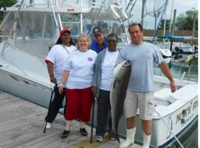 From left, Sharon Eleazer, first-place winner Katherine Swenson, Paul Chiepetta, Shannon Lyons, and captain Chris Broadbent at the Hooks For Heroes fishing tournament in Stamford.