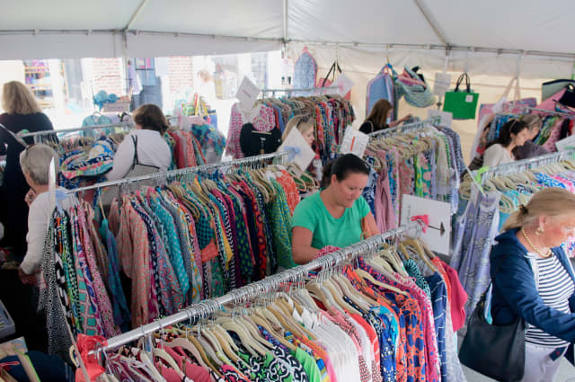 Shoppers stroll through a clothing display along the Post Road in Darien.