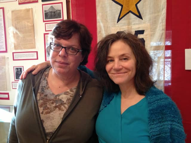 Natalie Barry and Debby Beece, Historical Society trustees and curators of the exhibit, with one of the displays.