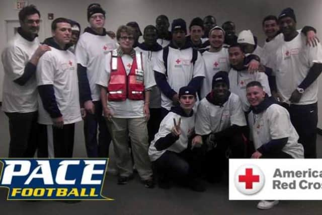 The Pace University football team volunteered at the Red Cross Warehouse in Jersey City, N.J. to help with Hurricane Sandy relief efforts.