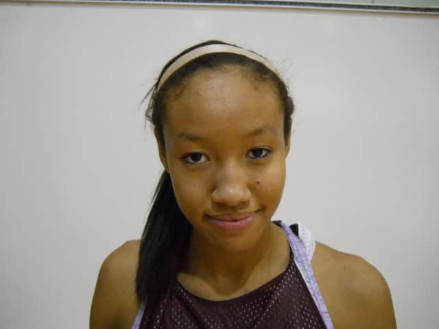 Ossining senior Saniya Chong signed a national letter of intent Wednesday to attend the University of Connecticut and play basketball.
