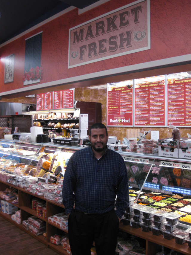 Ardsley Market Fresh owner Jamal Alrubai stands in front of his deli, which offers more than 75 sandwich options.
