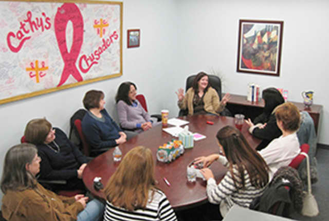 A support group meets in Support Connection's main offices in Yorktown.