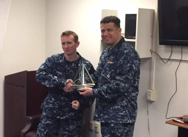 Petty Officer Second Class Scott Snider (left) with Lt. Vito Crecca, chaplain of the Naval Surface Forces Atlantic Command after re-enlisting in the U.S. Navy.