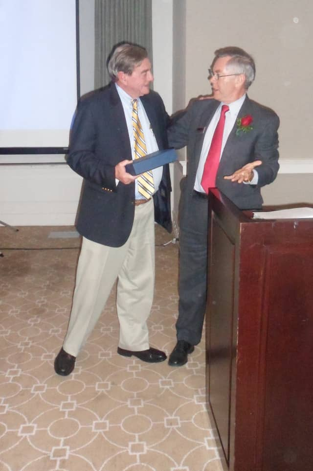 Walter Schalk, left, meets with outgoing chamber President Ralph Slater during Tuesday's Wilton Chamber of Commerce's Annual Dinner.