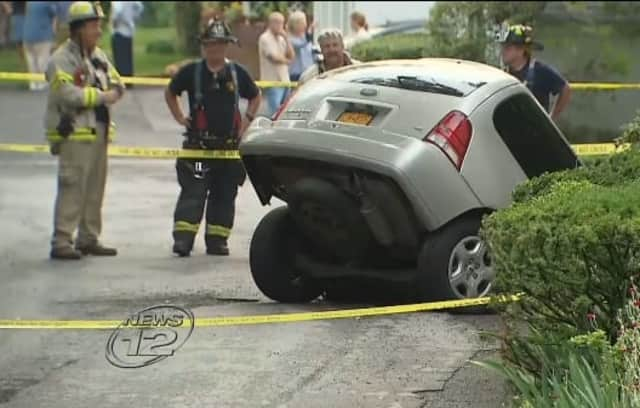 A woman's minivan was swallowed by a sinkhole Tuesday in hastings.