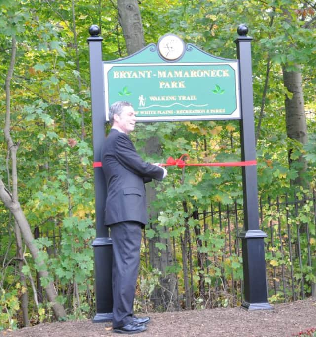 Mayor Tom Roach cutting the ribbon for the Bryant-Mamaroneck Park Walking Trail in 2013.