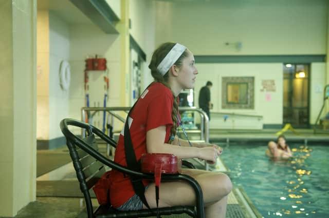 Beatrix Dalton keeps watch as a lifeguard at the Ridgefield Recreation Center's pool.