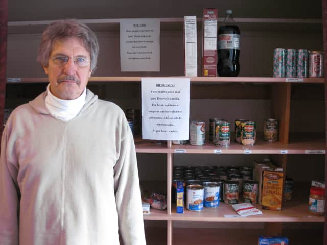South Presbyterian Church Senior Minister Joe Gilmore stands in front of his church's popular food pantry.