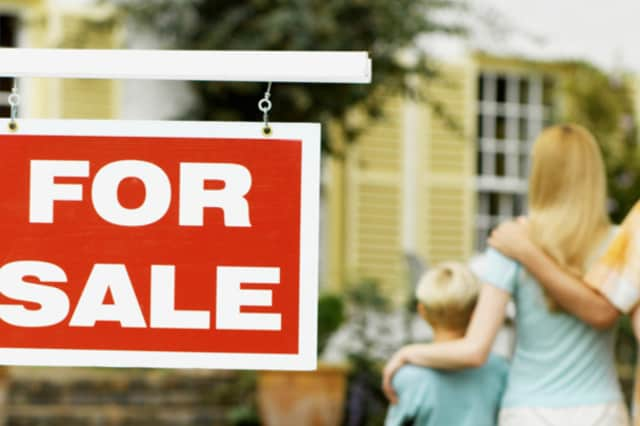 The median sale price for single family homes jumped by double digits in Norwalk and Darien, according to quarterly reports from real estate firms.