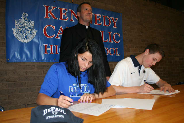 The Rev. Mark Vaillancourt, Kennedy's president and principal, looks on as Rachel Entwistle and Schuyler Bates sign with DePaul and Penn State, respectively, on the first day of the 2012 signing period.